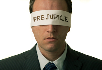 "Blindfolded man with ""prejudice"" text on the blindfold"